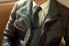 Knit-lined brown leather jacket with vest and striped shirt, tie