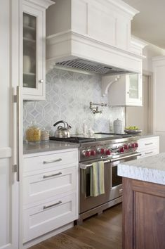 Love white cabinets, gray backsplash, etc.