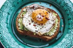 This Avocado Toast with Egg combines healthy whole wheat toast, a creamy avocado and cottage cheese spread and a fried egg. Each bite is heavenly!
