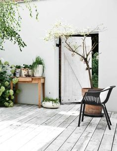 Outdoor styling white white walls and black accents