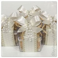 White bows with white pearl rosary. make the box from a folded soda bottle.