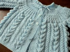 Really pretty baby jacket - Cables and round yoke. I find this shape is so much easier to knit top-down. Inspiration only, no pattern Baby Knitting Patterns, Knitting For Kids, Baby Patterns, Knit Baby Sweaters, Knitted Baby Clothes, Cardigan Bebe, Baby Cardigan, Crochet Baby, Knit Crochet
