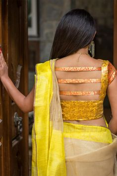 Buy House Of Blouse Yellow and orange brocade boat neck blouse online in India at best price.Shimmer and shine, this dual toned brocade blouse is to go an extra mile in the oomph factor. Blouse Back Neck Designs, New Saree Blouse Designs, Simple Blouse Designs, Stylish Blouse Design, Brocade Blouse Designs, Blouse Styles, Choli Designs, Salwar Designs, Sleeve Designs