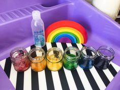 This sensory rainbow slime tutorial is SO MUCH FUN! Tell us your thoughts! Rainbow Slime, Clear Glue, How To Make Slime, Lollipop Sticks, Infant Activities, Food Coloring, Some Fun, Jar, Glass
