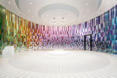 Really beautiful painted glass creates an incredible experience inside this Rainbow Chapel designed by COORDINATION ASIA