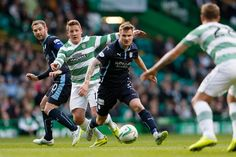 Celtic's Kris Commons in action with Dundee's Willie Dyer