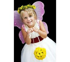 We loved the wings on this little flower girl. The kissing ball was all yellow daises as was the wreath for her hair.
