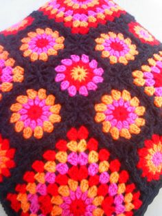 The pink orange red crochet granny square cushion by handmadebyria