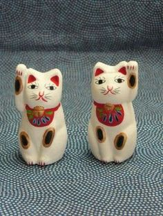 Japanese lucky cats in papier maché