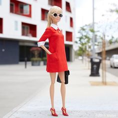 Mod inspired in round sunnies and a red shift dress.
