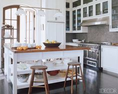 White always looks great with dark wood. We love the chic rustic vibe of this Florida kitchen, decorated by Robert Couturier and topped by a three-light chandelier by Ann-Morris antiques.