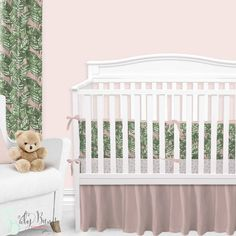 Palm leaf baby bedding, with a twist. This blush pink, white, and emerald green baby bedding set is simple yet sophisticated. We adore the watercolor brushstroke palm leaf print with a blush background that pairs perfectly with our blush and white fabric. This look has us feeling like we're in a tropical rainforest nursery.
