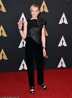 Elegant: The 46-year-old's fashion-forward outfit highlighted her slender frame as she posed for photographs