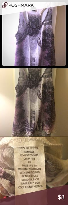 Sheer racer back tank Day trip sheer racer back tank. Scoop neck. White with pink and black pattern. Fits tighter around bust then loose in stomach. There are SLIGHT stains on inside of shirt on hem racer back in back. Cannot be seen on outside. Daytrip Tops Camisoles