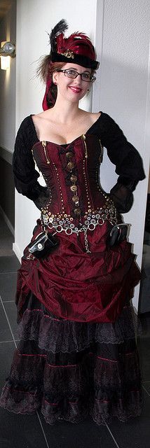 I could see myself wearing this. How lovely. The deep red is purrfect. IF you took the glasses off that would have me woondering the time. Steampunk