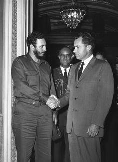 Cuban President Fidel Castro shaking hands with American vice-president Richard Nixon during a press reception in Washington, 1959.