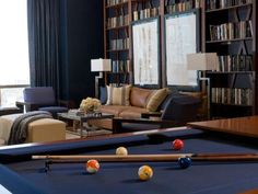 This luxurious library and living room has built-in wood bookshelves to match the beautiful wood pool table. A masculine library and game room, this is the perfect entertaining space. (wonder if the framed pics could be put on hidden hinges) Leather Furniture, Leather Sofa, Billard Bar, Pool Table Room, Pool Tables, Dining Room, Dining Table, Interior Design Atlanta, Wood Bookshelves