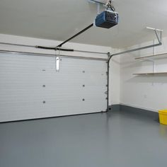 Clean garage with painted concrete slab floor.