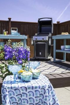 This amazing low maintenance backyard makeover features a grilling station, floating deck, and even beautiful artificial grass to help save water.