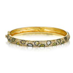 Payal Shah -URBAN JUNGLE FIERCE BANGLE Retail: $10,400 FLONT Member price: $8,840 DESCRIPTION  The Urban Jungle fierce bangle handcrafted in 18K yellow gold with (1.24 ct) slice diamonds, and (2.41ct) pave diamonds.  Membership: $299 a month Borrow: $329 for 4 days OWN $10,400 $8,840 FOR MEMBERS