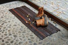 Floor mat made from thrifted belts