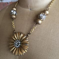 This fun 16 inch gold tone necklace features a 1970s brooch as a pendant. The center had clear rhinestones. The gold tone chain is accented by 2 large silver tone beads with rhinestones flanked by 2 gold Czech glass beads. Message me with questions or special requests.