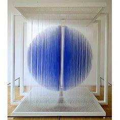 Sphere bleue de Paris (2000) Artist: Jesus Rafael Soto, The globe-like form in Sphere bleue de Paris appears to defy gravity, suggesting an energetic power-source, a world or universe. It is created by thin strands of blue rubber tubing, evenly spaced, and moved with a gentle wind or slight touch.