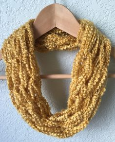 This scarf is perfect for any fall outfit. The golden color is a great complement to any pair of boots! This scarf is fun and great for those
