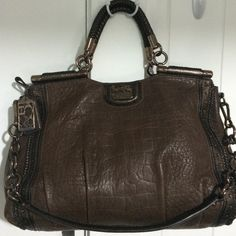 Coach's Limited Edition Madison Dowel Satchel Limited Edition 70th Anniversary Bag in a deep, rich expresso brown in pristine condition!  This bag comes with the 70th Anniversary jumble logo. Measurements 18x12.5x11 comes with the original dustbag. Coach Bags Satchels