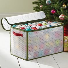 Real Simple Holiday 112-Count Ornament Storage provides convenient, organized storage for up to 112 Christmas ornaments. Durable storage box with side handles includes removable cardboard dividers to prevent ornament breakage. Zipper closure keeps out dus
