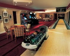 Finished basement with an emphasis on play - arcade games, cards table, bowling alley, billiards table and multiple televisions. Did I say bowling alley - you don't see that in too many homes.