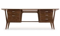 "Add fun and style to your workday with the Xavier desk's gorgeous retro design. With a distinctive silhouette reminiscent of a vintage teacher's desk, this piece will be a staple of any home. From the detailed wood piping to the asymmetrical drawer handles, this desk is unmatched in its attention to detail. Five deep and sturdy drawers allow for organization and virtually endless storage, and its long and smooth tabletop extends well past the drawers, providing an impressive 84"" of desk…"