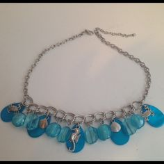 """DressBarn Seashore Blue Silver Necklace, NWOT New without Tags. Multiple blue beads of varying shades with 5 silver tone seashore themed charms including seahorse, clams, and crabs. Perfect for summer. Silver chain, adjustable length between 17"""" and 20"""". No problems to report. Dress Barn Jewelry Necklaces"""