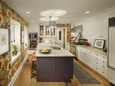 Contrasting island for prep and party. #design #msd #kitchen #walkingfordshowhouse #farmhouse #butcherblock #claudiamillsstudio #osborne&little #red #purple