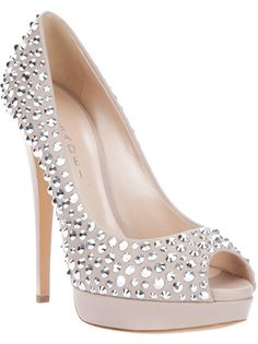 Nude leather pump from Casadei featuring a peep toe, a platform, a leather sole a stiletto heel and all-over Swarovski studding.