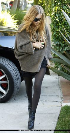 I like the balance of the chunky knit sweater, body con skirt, and sheer tights.