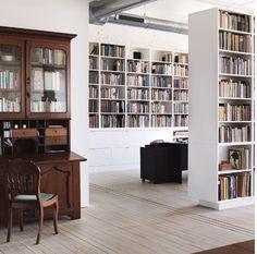 Simple interiors, white bookshelves, traditional desk.