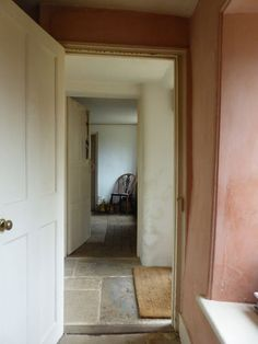 Hardy's cottage. Cob walls, Purbeck stone floor, setting plaster pink colour.