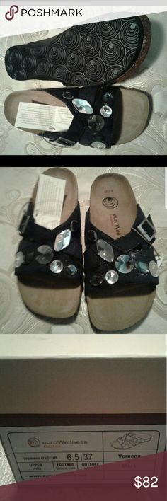 NEW JEWELED BLACK SLIDES, NEW IN BOX. SIZE 6.5 These are a little bit more dressy than Birkenstock slides. SIZE 6 1/2, I'm a 7/8 and they fit. Really nice, natural CORK, real genuine suede..Brand is EuroWellnes, same makers of Birkenstocks. EuroWellness by Birkenstocks Shoes Sandals