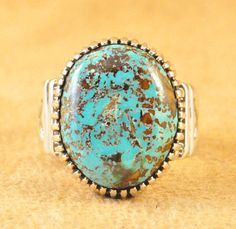 Handmade ring, with natural Royston Turquoise, by Navajo artist Ned Nez.
