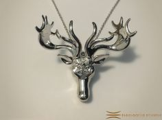 Mistletoe Reindeer Pendant 3d printed Small version in Rhodium Plated on White fabric (Chain not included)