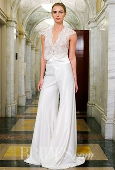 Brides.com: . Sleeveless lace crop top with wide-leg silk pants, Victoria Kyriakides