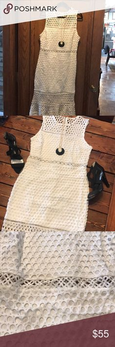 Lulu's white crochet lace sheath dress This dress is NWOT! Gorgeous modern sheath dress with a mod crocheted lace. It has a see through floral lace feature at the waist for an amazingly slimming look. It has a knee length lining with a midi length over lay for a sexy look but plenty of coverage. Lulu's Dresses Midi