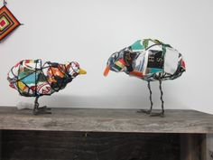 Trash Bird made from trash, wire, and yarn. Great idea for a calder project.