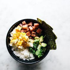 """breakfast bowl goals: fluffy koshihikari rice, crispy spam cubes, chopped fried egg, avocado, arugula and a bit of bonus seaweed """