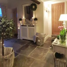 Stone floor Radiator cover Bay tree Baskets and throws Hall Flooring, Stone Flooring, Cottage Living Rooms, Cottage Interiors, Style At Home, Bungalow Hallway Ideas, Hallway Colours, Snug Room, Radiator Cover