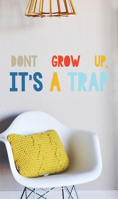 Dont Grow Up its a Trap - WALL DECAL    20w x 8h Fully removable and reusable wall decals that will brighten and add character to any room.