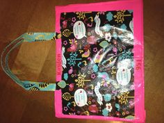 Girl Scout sit upons made with cute bags from JoAnns. Newspaper inside and duct tape trim. So easy!!!