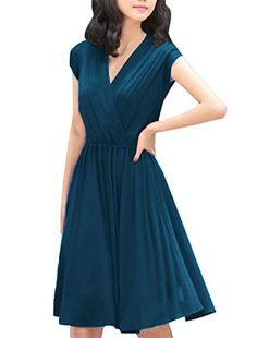 Flowing and elegant, this dress features a #crossover v neck, cap sleeves, and a #pleated skirt. It is comfortable and sultry yet modest, perfect for a summer day...