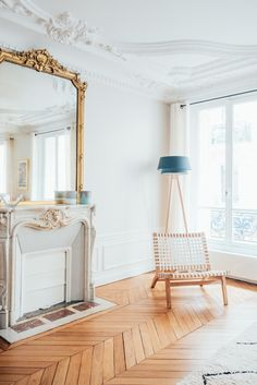 parisienne chic - love the parquetry floors and the gorgeous mantel + mirror combo